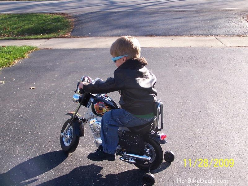 Here are just a few pictures and several videos of Blake trying out his new motorcycle outside.  It's really underpowered and seems to have no forward freewheel sprocket to save the motor.  If he could coast faster than the motor without forcing it to turn, that would have been better...  Maybe I'll Tool Time Tim Taylor it and improve upon the original design of the bike....