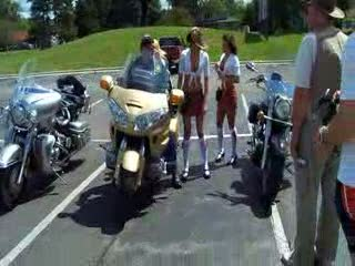 Melanie, Dee and Olympia posing with a Goldwing and it's owner from:DotComd