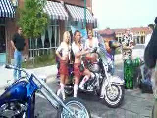 Melanie, Kayla and Amanda posing with the airbrush painters bike from:DotComd