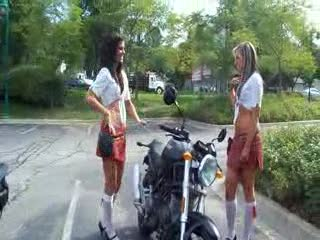 Caitlyn and Katy working out whether or not to get on the bike from:DotComd