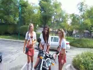 Add Comment To: Caitlyn and Kayla hugging on a bike and Katy standing by