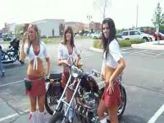 The tk ladies posing next to an old and dirty bike from:DotComd