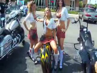 Add Comment To: Kayla, Katy and Anna posing backwards on a chopper