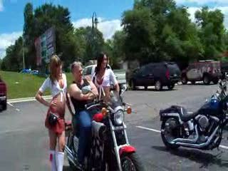 Dee and Mandi posing with a Yamaha VMax and it's owner from:DotComd