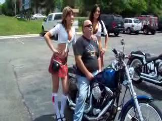 Dee and Mandi posing with a Harley Davidson and it's owner from:DotComd