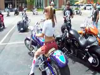 Dee sitting on a Gorgeous Purple Chopper from:DotComd