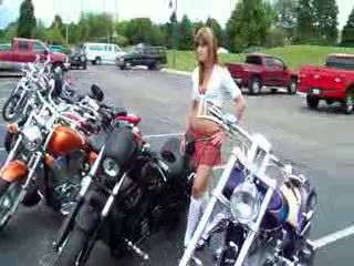 Dee posing with another bike she likes from:DotComd